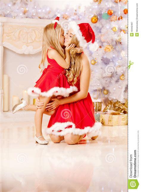mom  daughter dressed  santa celebrate christmas family  stock photo image