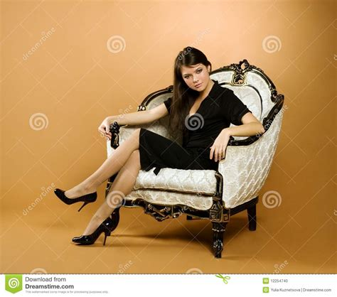woman in armchair young woman sitting in armchair stock photo image 12254740
