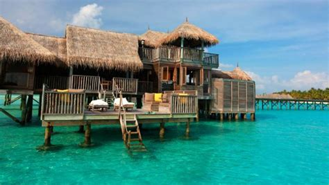 Luxury Modern Bathroom - stunning overwater bungalows around the world for a breathtaking holiday