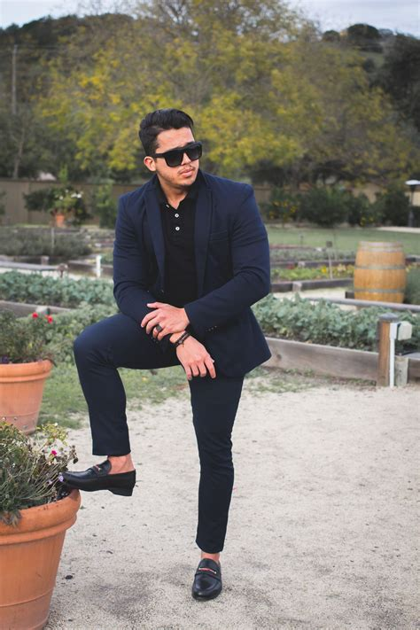 gucci loafers with suit navy suit black polo and gucci loafers gucci loafers
