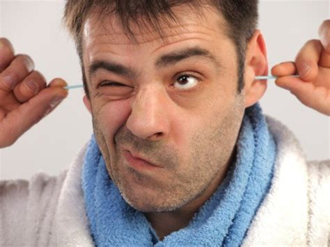 the manliest way to remove your ear hair gq how to remove earwax safely at home