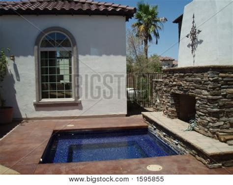 picture or photo of outdoor patio with in ground spa and