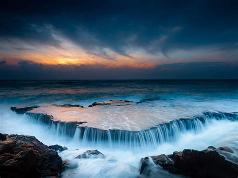 sunset ocean wave plate  volcanic rock waterfall