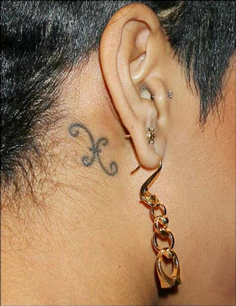 tattoo behind rihanna s ear discover the secrets behind 18 of rihanna s tattoos ritely