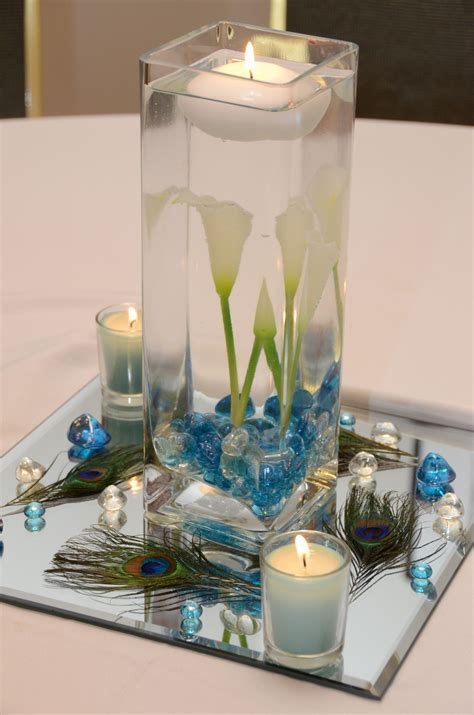 Centerpiece 2 (guest tables) Peacock feather and calla