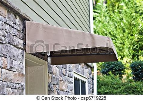 small awnings over doors pictures of small awining over door a small canvas awning over an csp6719228