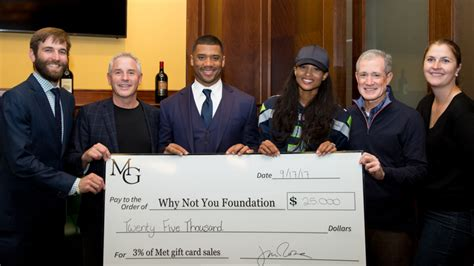 Metropolitan Grill Gift Card - russell wilson and ciara accept 25k check from metropolitan grill in new partnership