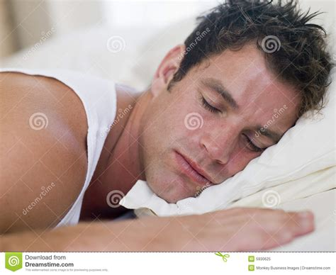 guy in bed man lying in bed sleeping royalty free stock photo image