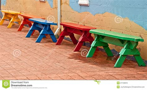 colored benches primary colored benches in row on bricks royalty free stock photos image 27129818