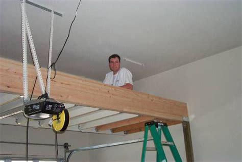 17 best images about above garage loft on pinterest nighthawk garage loft project over the garage door