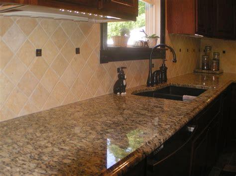 giallo napoleone granite counterops tile backsplash