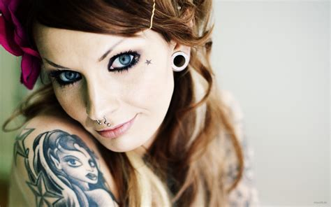 women with tattoos with summer style smile tattoomagz