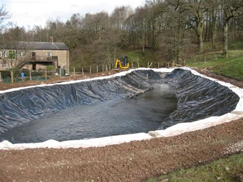 backyard pond liners large pond liner installation the excavated pond is