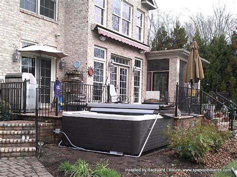 backyard leisure concord hot tub with cover lifter built off of back deck hot