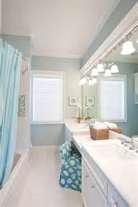 Traditional coastal bathrooms all in the same home completely
