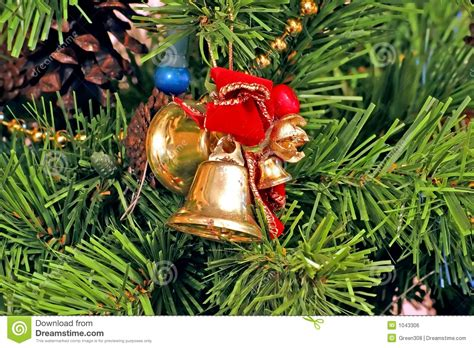 bells and bows christmas tree ornaments stock photo