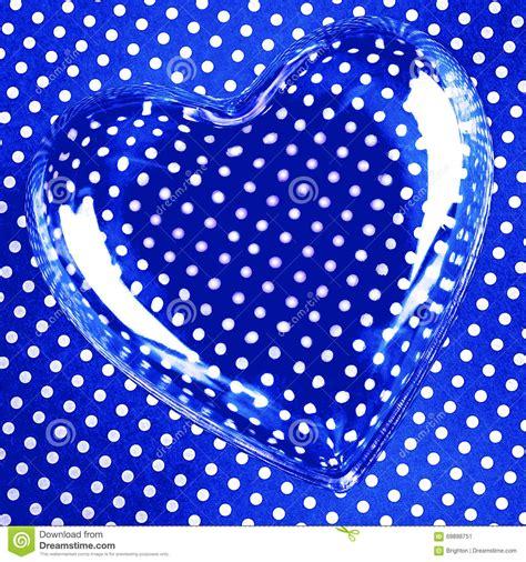 dot pattern on glass heart over blue polka dots stock photo image 69898751