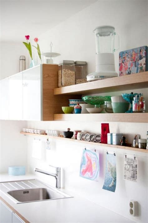 adding shelves to kitchen cabinets 21 clever ways to maximize kitchen cabinet storage