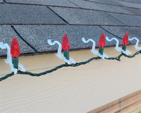 hanging outdoor christmas lights hooks how to professionally hang holiday lights eclean magazine