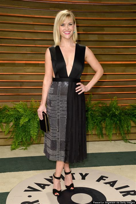 reese witherspoon wows in plunging gown at vanity fair