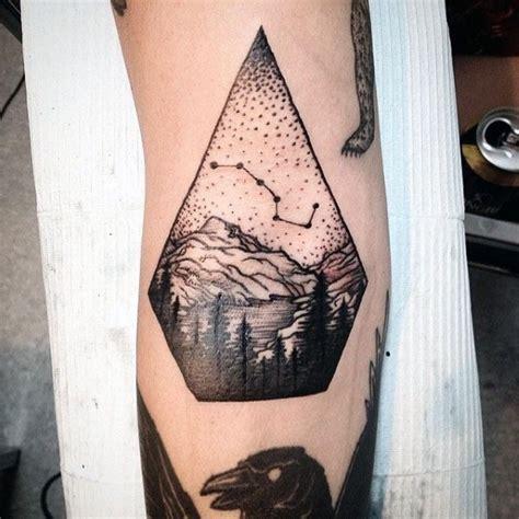 how much would a small just black ink tattoo cost picture kleines schwarzes tierkreissymbol mit berge tattoo am arm