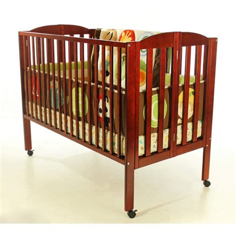 Portable Crib Dimensions by Folding Size Crib On Me