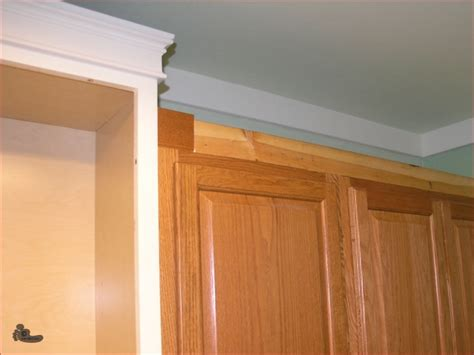 molding on kitchen cabinets perfect cabinet molding on maple cabinet crown molding