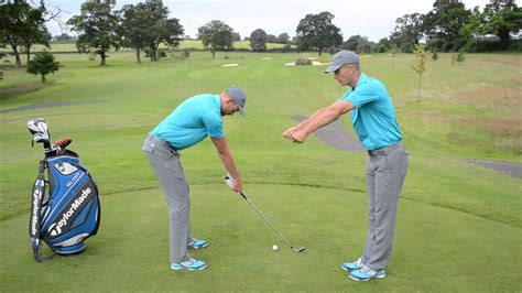 what do the hands do in the golf swing how close should you stand to the golf ball youtube