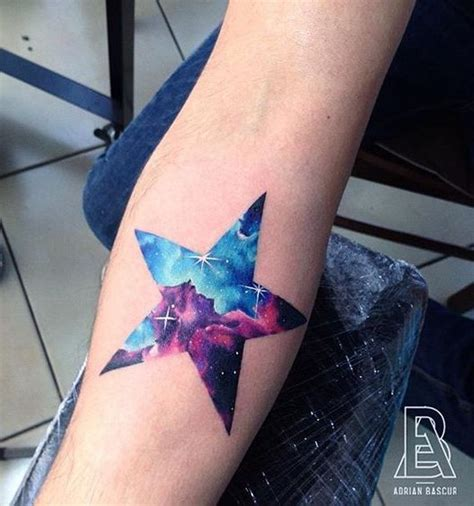 picture of galaxy star arm tattoo