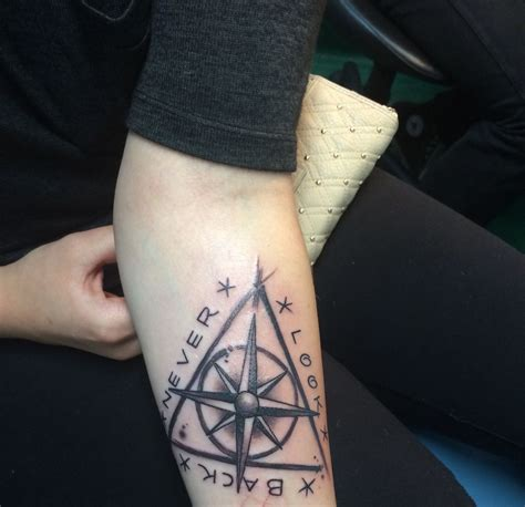 alis aquilae tattoo quot never look back quot mixed with a compass and the deathly