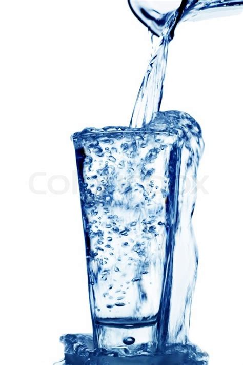 What To Fill Glass With Water Is Filled Into A Glass Of Water Stock Photo