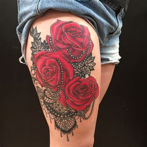 red rose pearl and lace thigh tattoo by colby morton