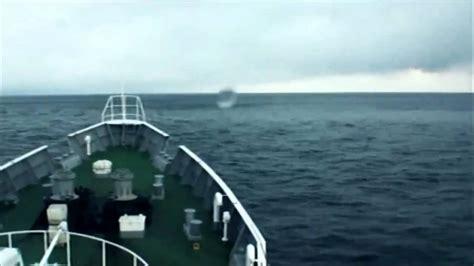 boat riding wave japan tsunami coast guard ship rides over the tsunami