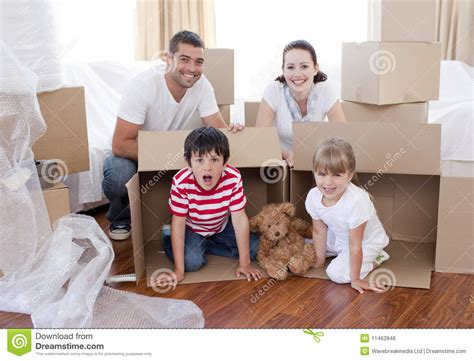 around the house movers family moving house with boxes around royalty free stock image image 11462846