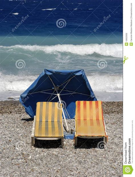 Surf The Web With The Umbrella by Surf Chairs And Umbrella Royalty Free Stock Photo Image
