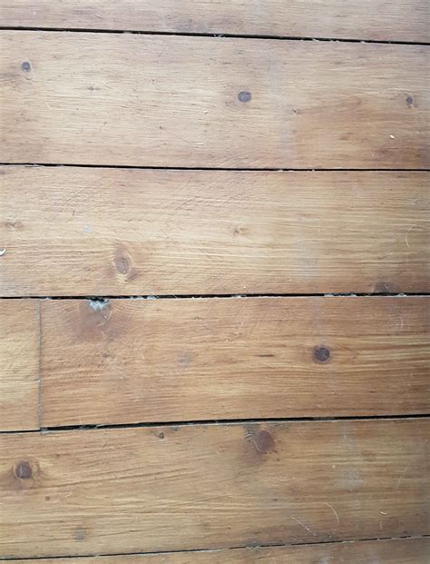 Should I sand my traditional wood floor before staining