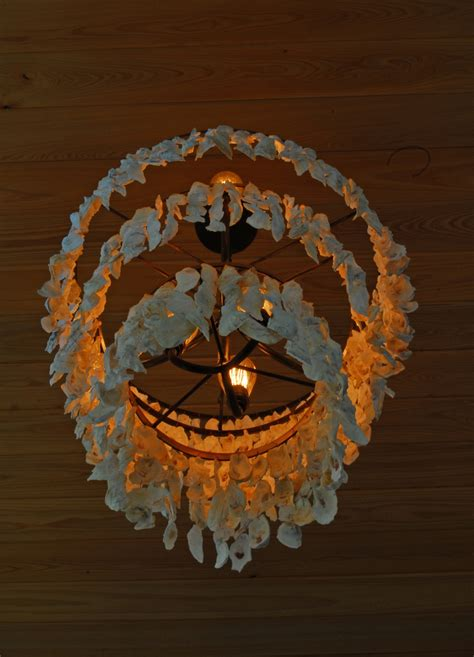 oyster chandelier three tiered oyster shell chandelier r mended metals llc