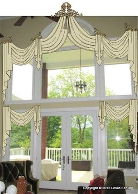 double window treatments double layered swags and jabots two story windows