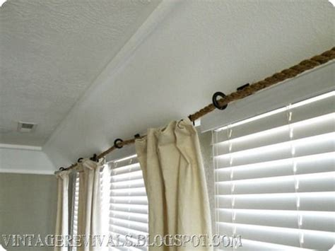 cute curtain rods use rope to hang curtains across large windows rather than