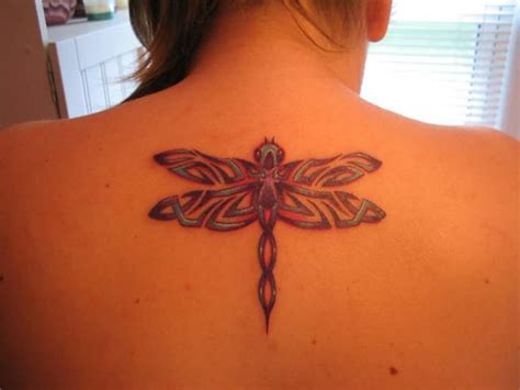 tribal dragonfly tattoo meaning fly along with these cool bird tattoos
