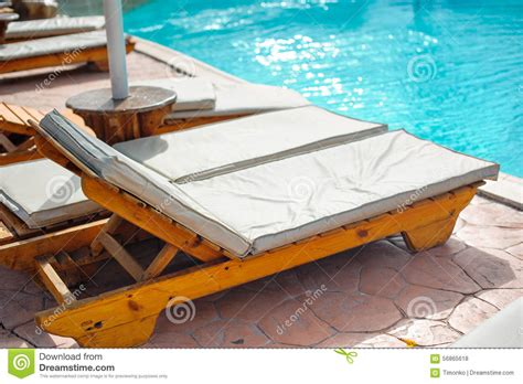 pool beds wooden bed beside the pool stock photo image 56865618