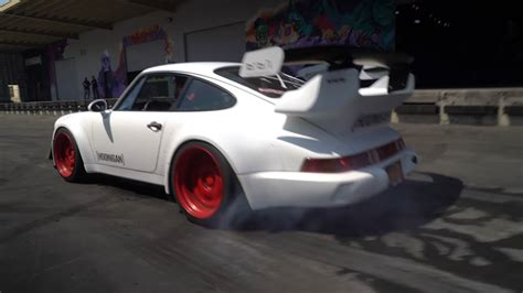 hoonigan porsche watch the hoonigan rwb porsche lay serious rubber the drive