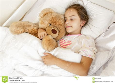 cute teenager girls sleeping stock photos and images cute girl sleeping and hugging big teddy bear at bed stock