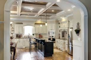 Painted white cabinets with glazing and painted black island