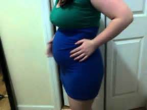 Very full very round chubby belly in a tight dress