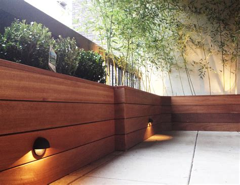 modern wood planter terrace with custom planter box built with mahogany wood