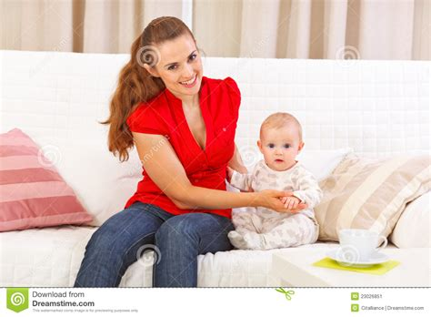 mom on sofa baby sitting with mother on sofa stock image image 23026851