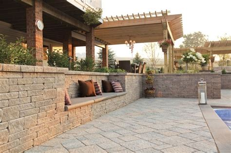 a retaining wall with a built in bench is great for a place to sit and dry off near the swimming
