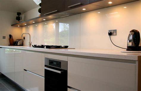 white kitchens with glass splashbacks bold white glass splashback with downlights to show