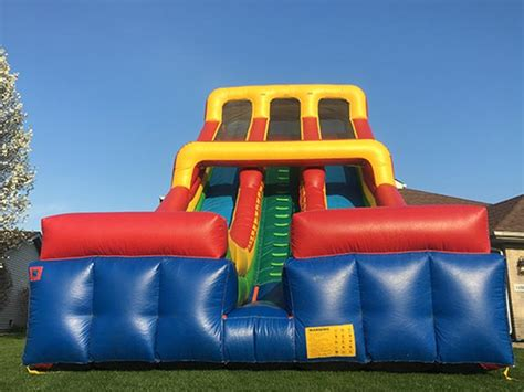 Jumpy Houses by 25ft Dual Slide Two The Bounce House Company